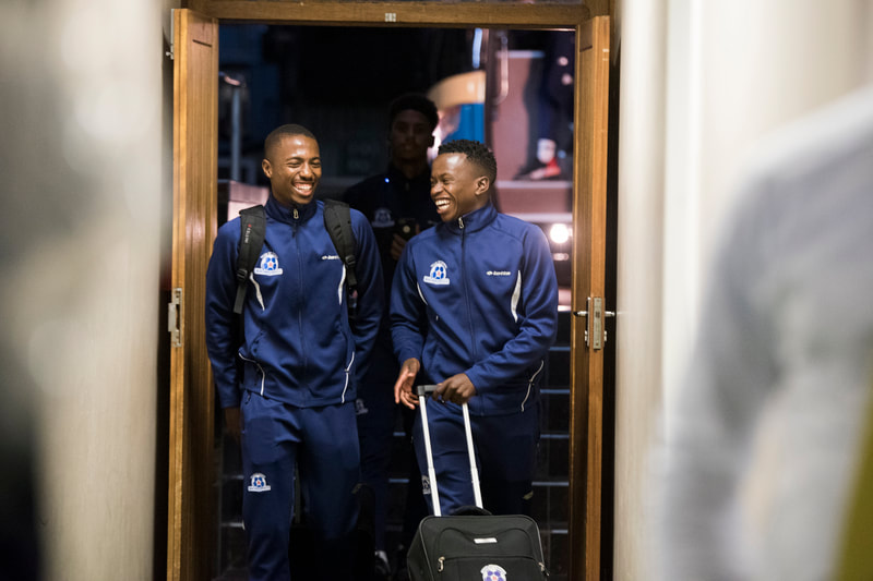 Siphesihle Ndlovu and Bandile Shandu of Maritzburg United, arriving at the stadium in good spirits. Match between Maritzburg United and Bloemfontein Celtic at the Harry Gwala Stadium on the 5th of April 2019 © Image: BOOGS Photography / Andrew Mc Fadden
