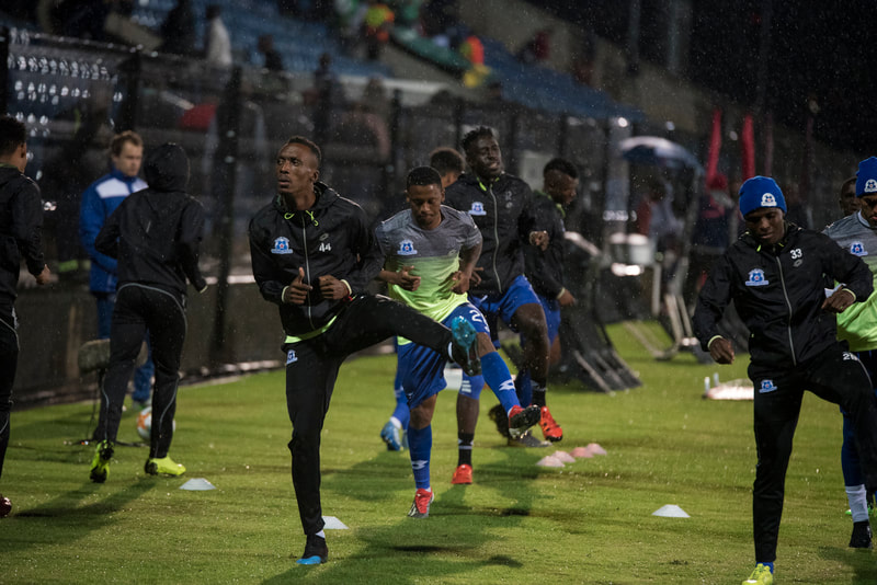 Maritzburg United players warming up before the game. Match between Maritzburg United and Bloemfontein Celtic at the Harry Gwala Stadium on the 5th of April 2019 © Image: BOOGS Photography / Andrew Mc Fadden