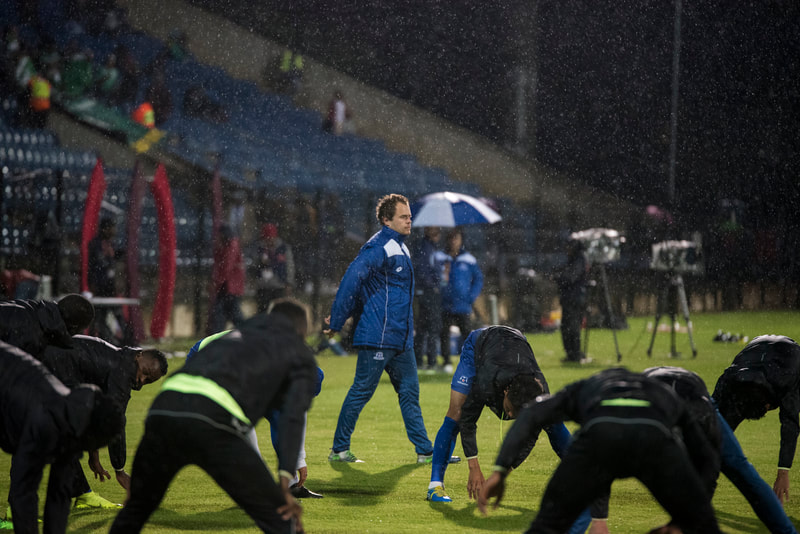 Andrew Coppin, Maritzburg United Physio, making sure all the players are warming up correctly. Match between Maritzburg United and Bloemfontein Celtic at the Harry Gwala Stadium on the 5th of April 2019 © Image: BOOGS Photography / Andrew Mc Fadden