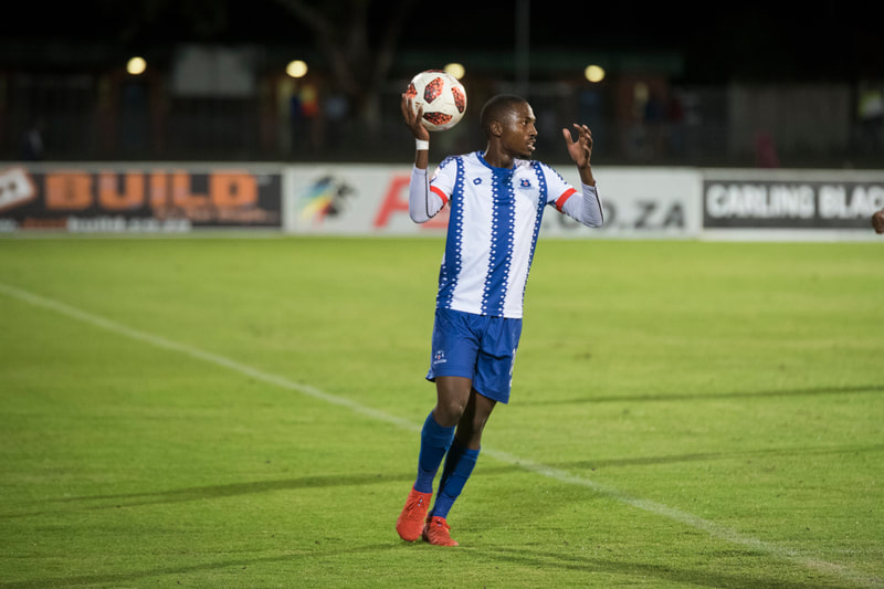 Bandile Shandu of Maritzburg United, throws in. Match between Maritzburg United and Bloemfontein Celtic at the Harry Gwala Stadium on the 5th of April 2019 © Image: BOOGS Photography / Andrew Mc Fadden