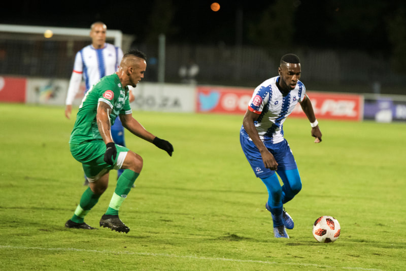 Fortune Makaringe of Maritzburg United, takes on the defence. Match between Maritzburg United and Bloemfontein Celtic at the Harry Gwala Stadium on the 5th of April 2019 © Image: BOOGS Photography / Andrew Mc Fadden