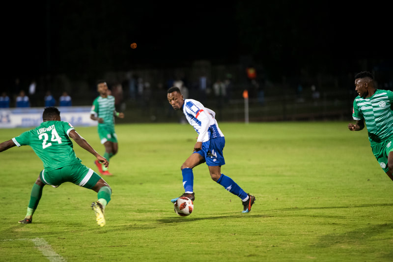 Yannick Zakri of Maritzburg United, crosses in the ball. Match between Maritzburg United and Bloemfontein Celtic at the Harry Gwala Stadium on the 5th of April 2019 © Image: BOOGS Photography / Andrew Mc Fadden