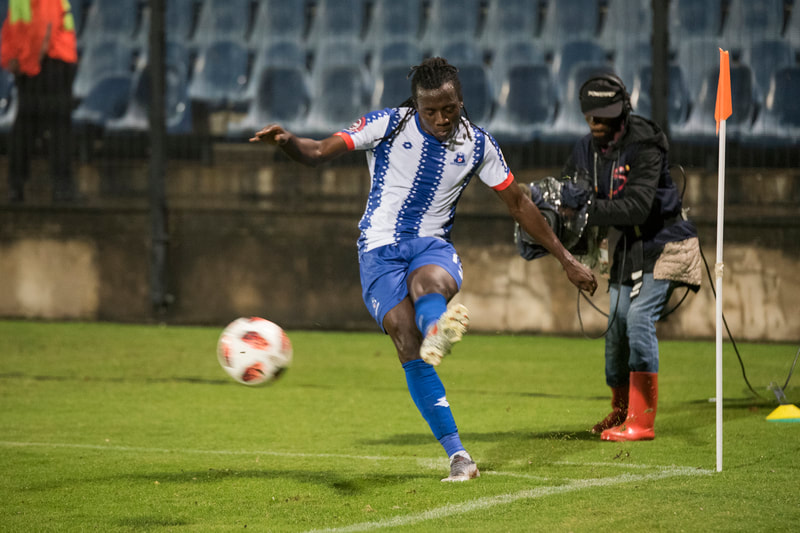 Allan Kateregga of Maritzburg United, kicks in a corner. Match between Maritzburg United and Bloemfontein Celtic at the Harry Gwala Stadium on the 5th of April 2019 © Image: BOOGS Photography / Andrew Mc Fadden