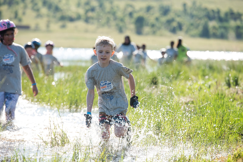 The mud skippers having lots of fun in the bubbles, water and on the bike during the Cordwalles Mudman at Midmar Dam