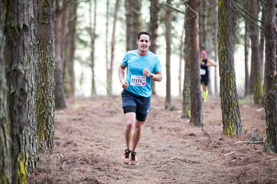 Nicholas Riddin all smiles as he edges closer to the finish of his trail run - (c) Andrew Mc Fadden / BOOGS Photography