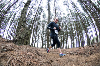 Molly-Gayle Valentine sweeps her way through one of the single track sections of the trail run - (c) Andrew Mc Fadden / BOOGS Photography